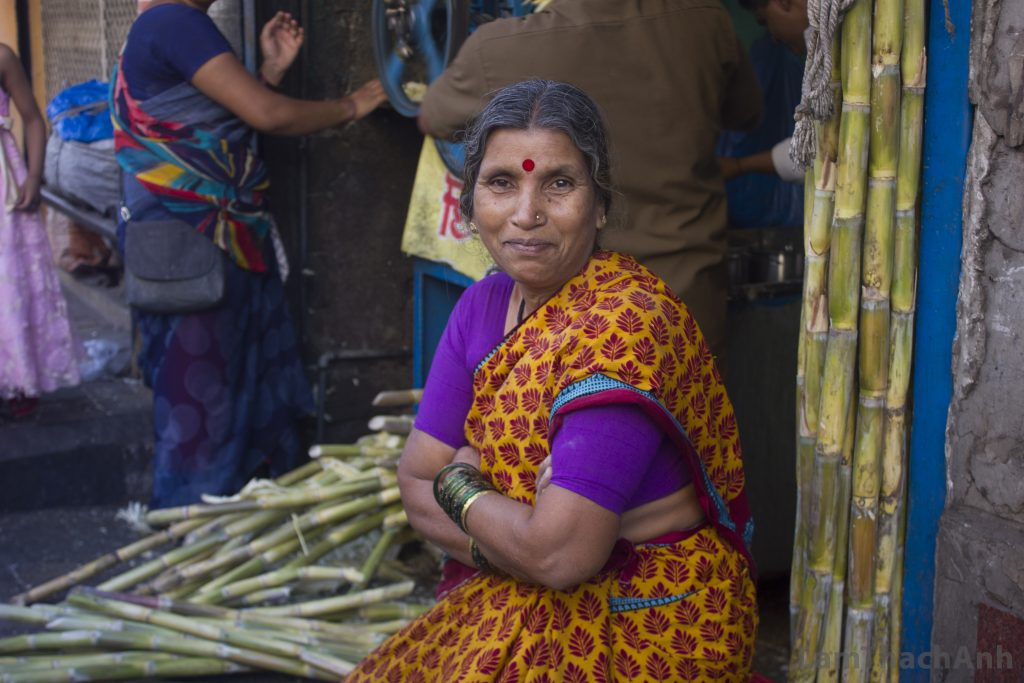 The woman selling sugarcane next door told us that she wanted a picture. And she looked directly to the camera with that smile